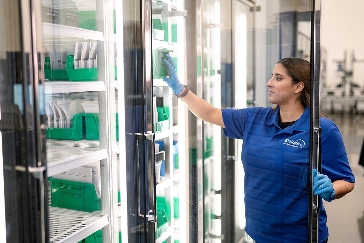 woman opening door to medication storage area