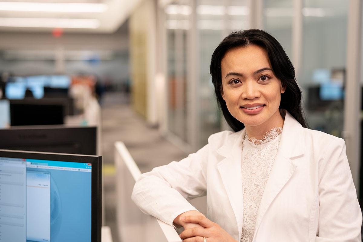 female customer service representative smiling at camera
