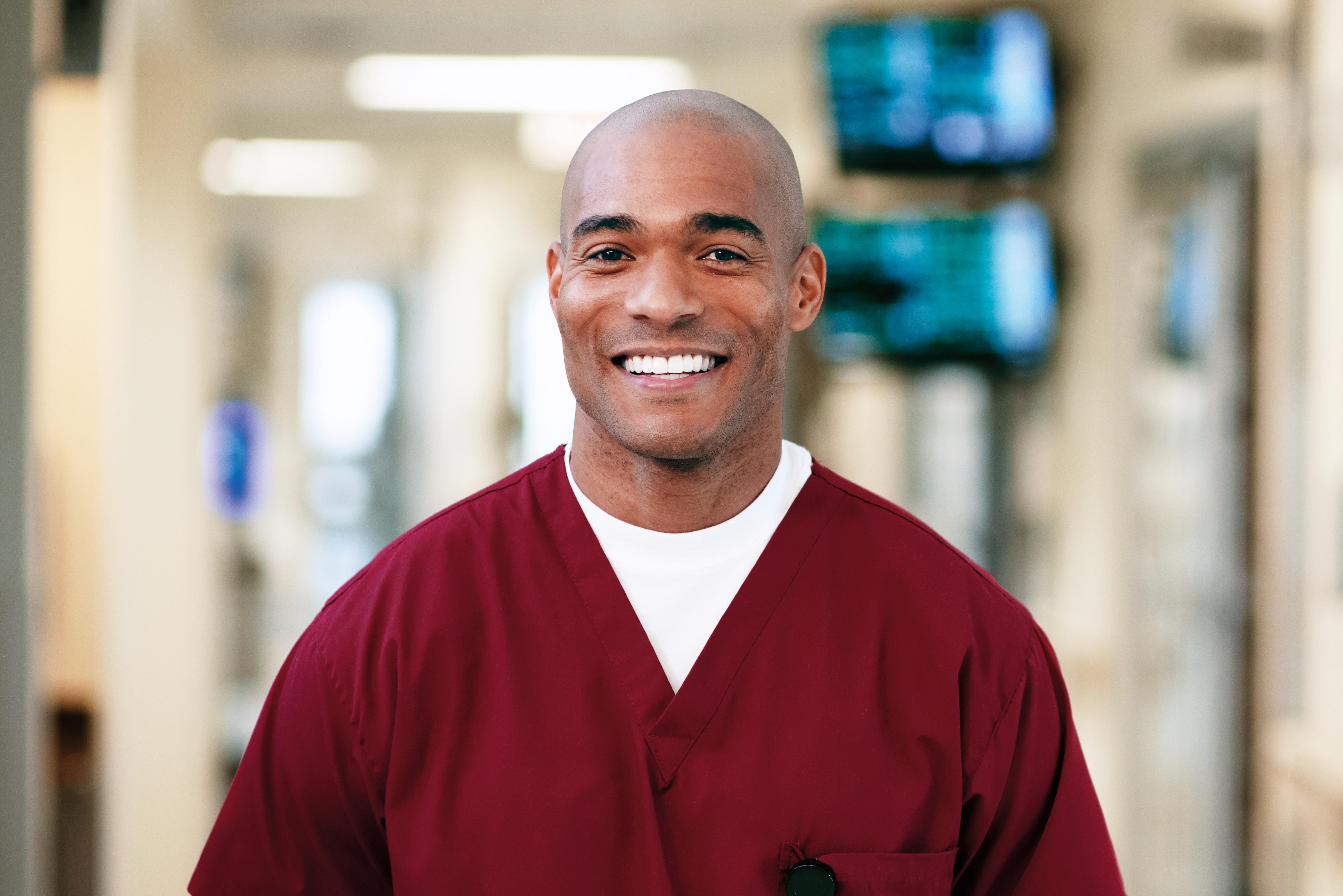 A male nurse in a hospital hallway